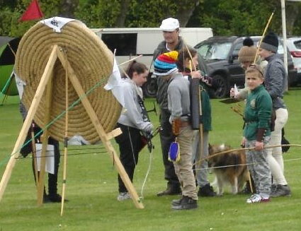 Martin helps the junior competitors score their arrows at a shorter distance.